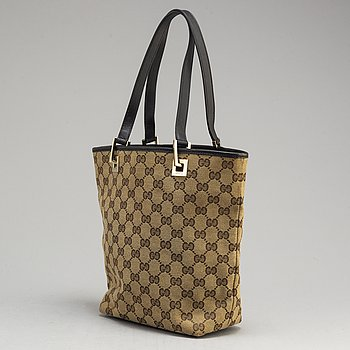 GUCCI, a canvas and leather bag.