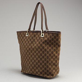 GUCCI, a tote bag.