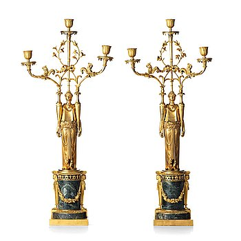 104. A pair of French Directoire three-light candelabra, circa 1800.
