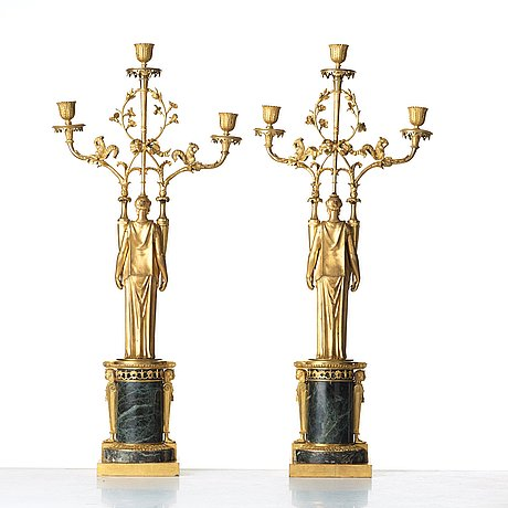 A pair of french directoire three-light candelabra, circa 1800.