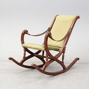 a late 19th century rocking chair.