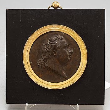 A Swedish Empire copper and gilt bronze portrait medallion representing Johan Tobias Sergel.