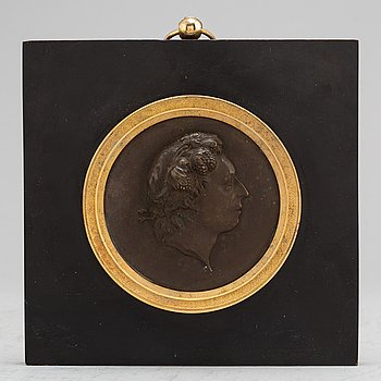 A Swedish Empire copper and gilt bronze portrait medallion representing Carl Michael Bellman.