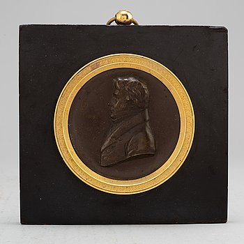 A Swedish Empire copper and gilt bronze portrait medallion representing Jöns Jacob Berzelius.
