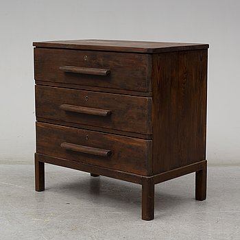 AXEL EINAR HJORTH, an attributed, stained pine chest of drawers, 1930's.