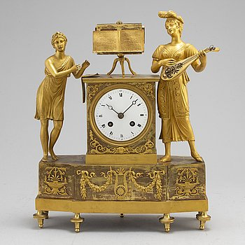 A French Empire gilt bronze mantel clock, first half of the 19th century.