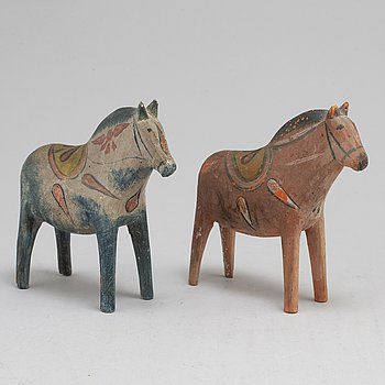 two painted wooden horses from the early 20th century.