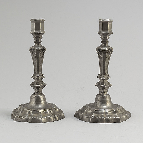 A pair of pewter régence style candlesticks, first half of the 20th century