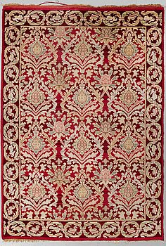 A RUG, a semi-antique Spanish, ca 239,5 x 167,5 cm (as well as ca 2 cm flat weave at the ends),