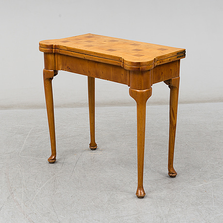An end of the 19th century queen anne style card table