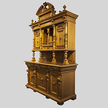 A renaissance style oak cupboard from around 1900.