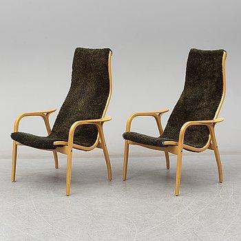 A pair of 'Lamino' chairs by Yngve Ekström.