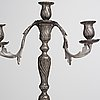 A pair of swedish rococo pewter three-light candelabra by anders wetterquist, stockholm 1774.