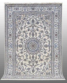 A CARPET, Nain part silk, 303 x 203 cm.