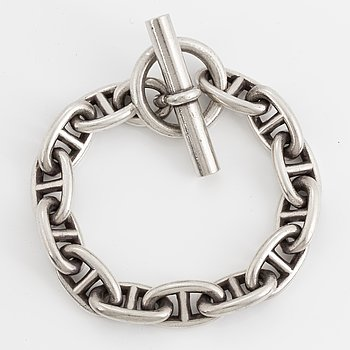 Hermès silver bracelet.