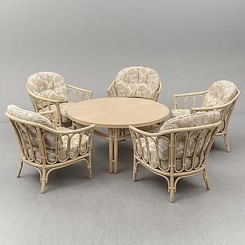 a 1980 set of a table end six bamboo chairs.