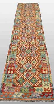 A carpet, Kilim, ca 411 x 77 cm.