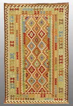 A carpet, kilim, around 246 x 157 cm.