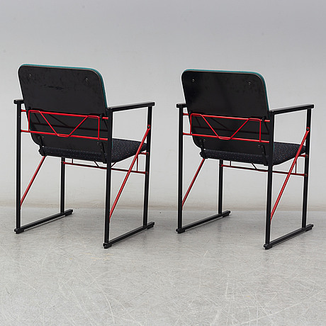 A pair of arm chairs and a coffee table by yrjö kukkapuro, avarte, finland, 1980s