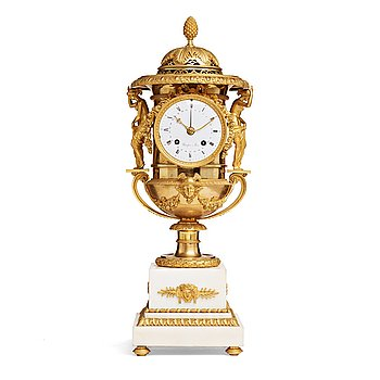 135. A French early 19th century mantel clock.
