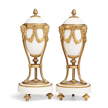 113. A pair of Louis XVI-style candlesticks, circa 1900.