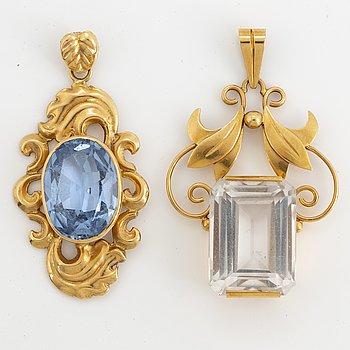 2 18K gold pendants.