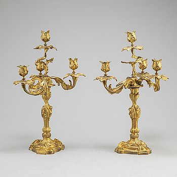 a pair of rococo-style candelabras from around 1900.