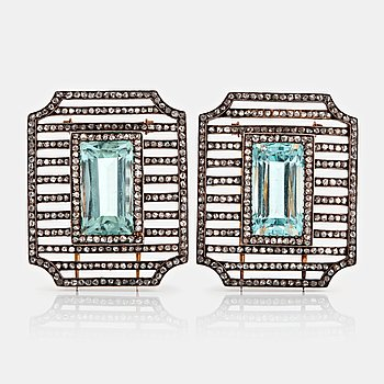 1095. Fabergé double clip brooches, workmaster Albert Holmström, set with aquamarines and rose-cut diamonds.