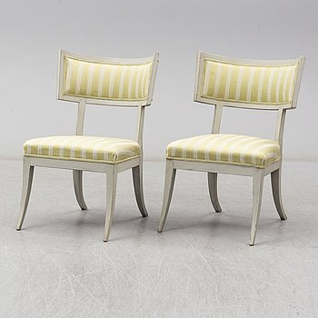 A mid 19th century chair and a first half of the 20th century chair.