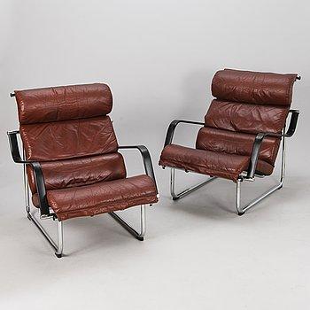 """YRJÖ KUKKAPURO, A pair of late 1900s open armchairs, """"Remmi"""" Avarte."""