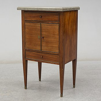 An end of the 19th Century mahogany bedside table with a stone top.