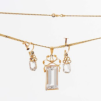 STIGBERT chainn and pendant and earrings, 18l gold and rock crystal.