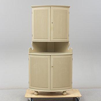A mid 20th century corner cabinet.