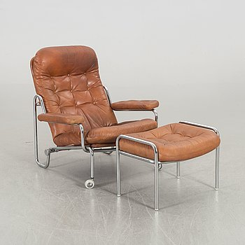 A SWEDISH ARMCHAIR WITH STOOL, Göte möbler Nässjö 1970's.