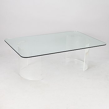 A glass top coffee table on acrylic base, 2000s.