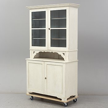 A mid 19th century painted display cabinet.