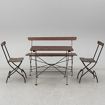 A garden sofa, table and a pair of chairs, first half of the 20th century.