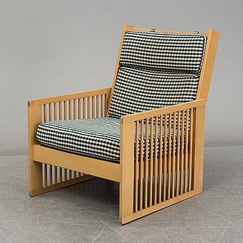 BEN AF SCHULTEN, a birch model 444 easy chair from Artek, Finland.