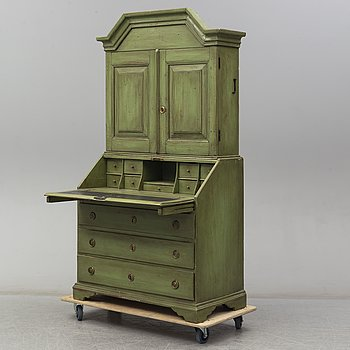 A 18th Century painted cabinet with drawers.