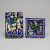 Two ceramic tiles.