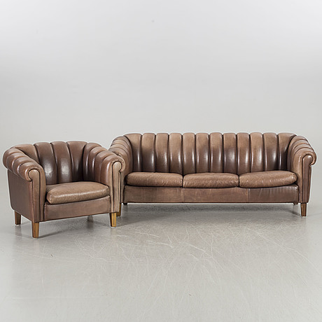 A leather sofa and armchair, 20th century latter part