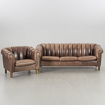 A leather sofa and armchair, 20th century latter part.