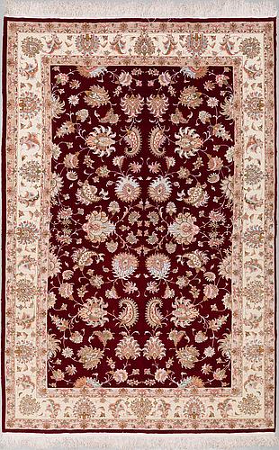 A carpet tabriz, part silk, ca 301 x 195 cm