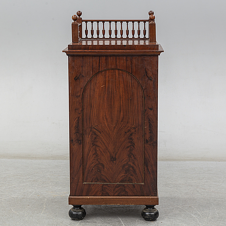 A swedish empire cupboard, first half of the 19th century.