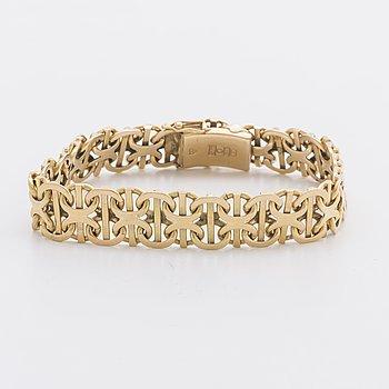 An 18 Carat gold bracelet weight ca 33,4 gr.