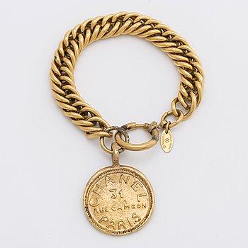 A Chanel bracelet.
