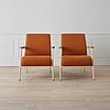 """A pair of """"fauteuil de salon"""" by jean prouvé, vitra."""