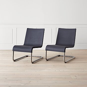 "A pair of "".06"" easy chairs by Maarten Van Severen for Vitra."