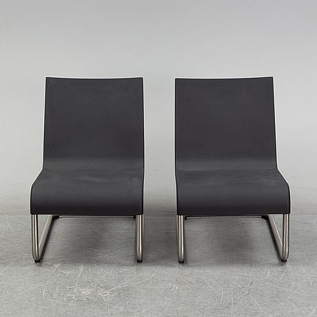 "Maarten van severen, a pair of "".06"" easy chairs for vitra."