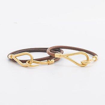 A piar of Hermès bracelets.